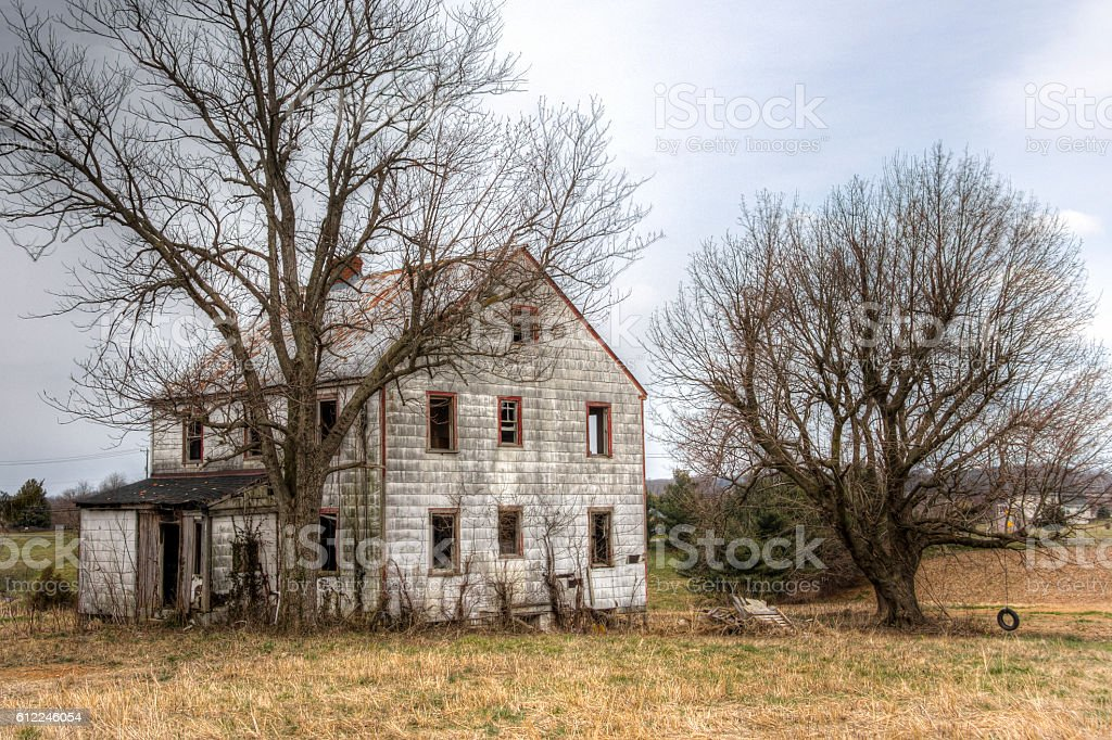 Abandoned White House With Tire Swing On The Right, HDR stock photo