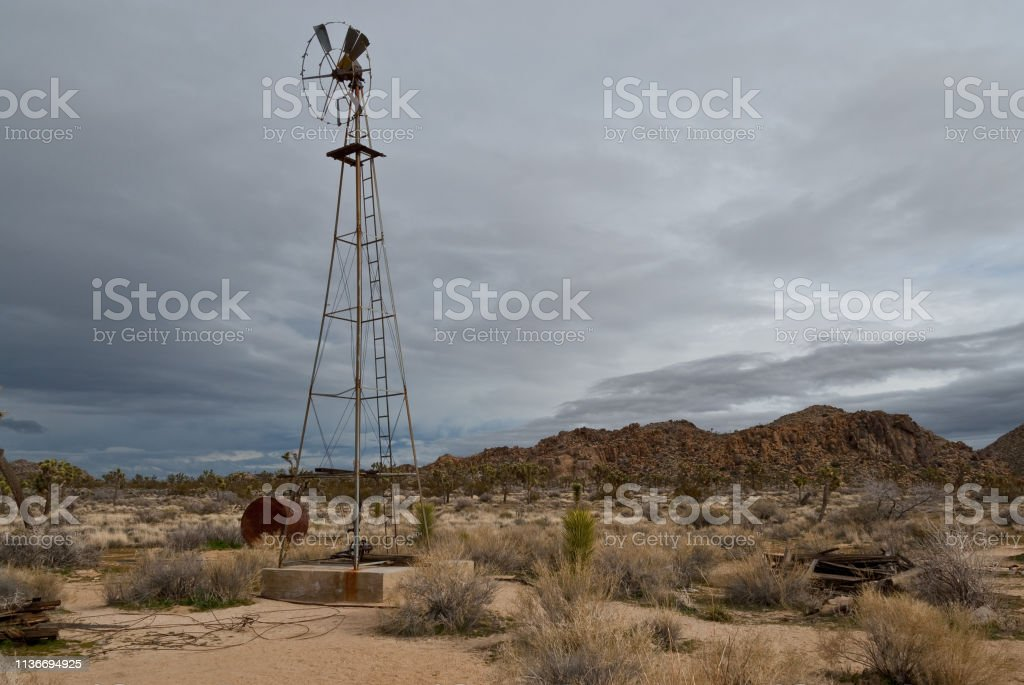 Abandoned Windmill in the Desert stock photo