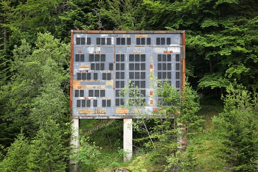 Saint-Nizier du Moucherotte, France - June 25 2017: Abandoned winter olympic site at the ski jumping large hill in Saint-Nizier du Moucherotte, France. The site has been built for the winter olympic games in 1968 in Grenoble