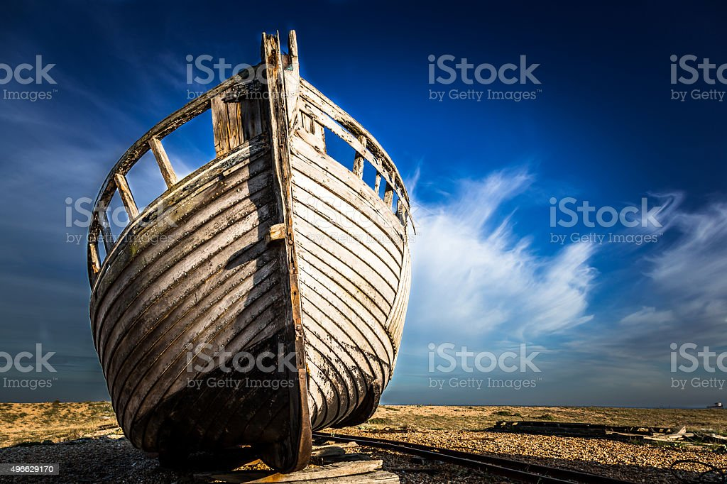 Abandoned Wooden Boat Wreck On Deserted Beach stock photo