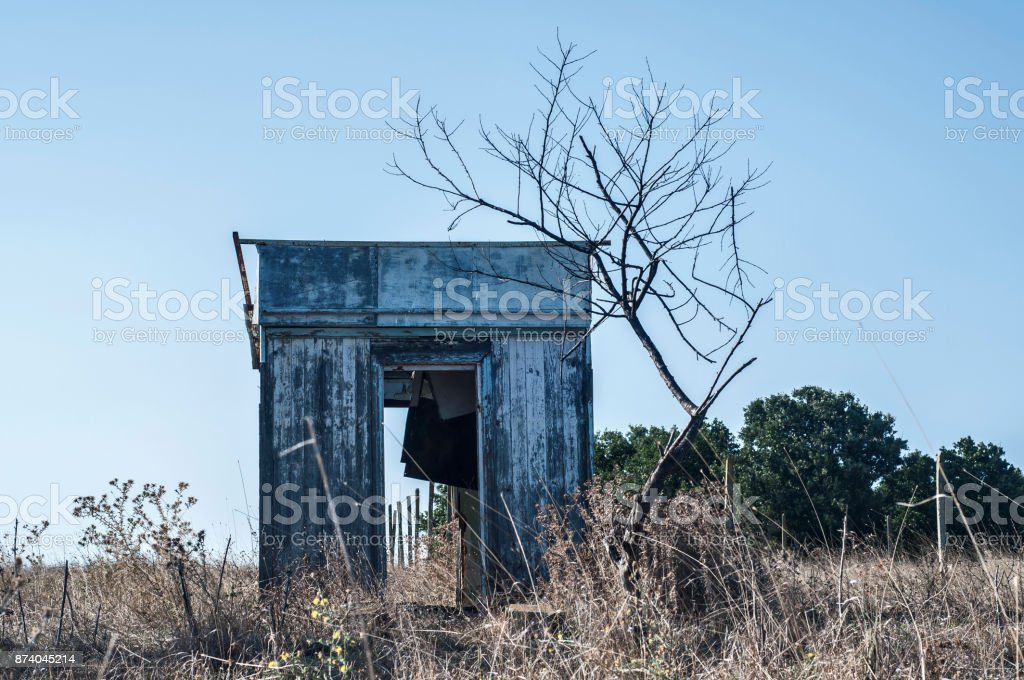Abandoned wooden bungalow stock photo