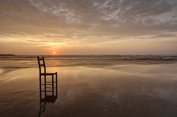 Abandoned Wooden Chair Beach Sunset Oregon Coast Reflection Horizontal HDR stock photo