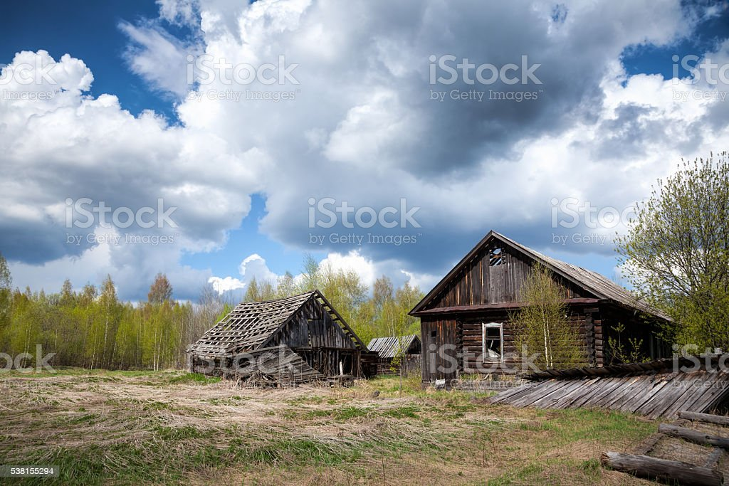 Abandoned wooden house in a deserted village stock photo