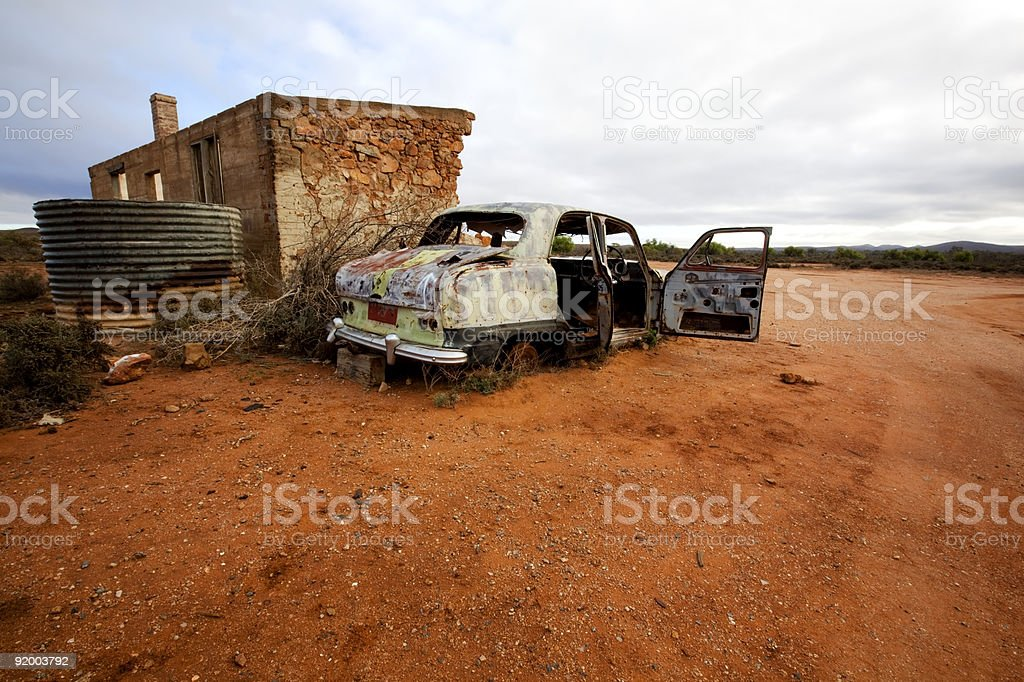 Abandoned Wrecked Car and House stock photo