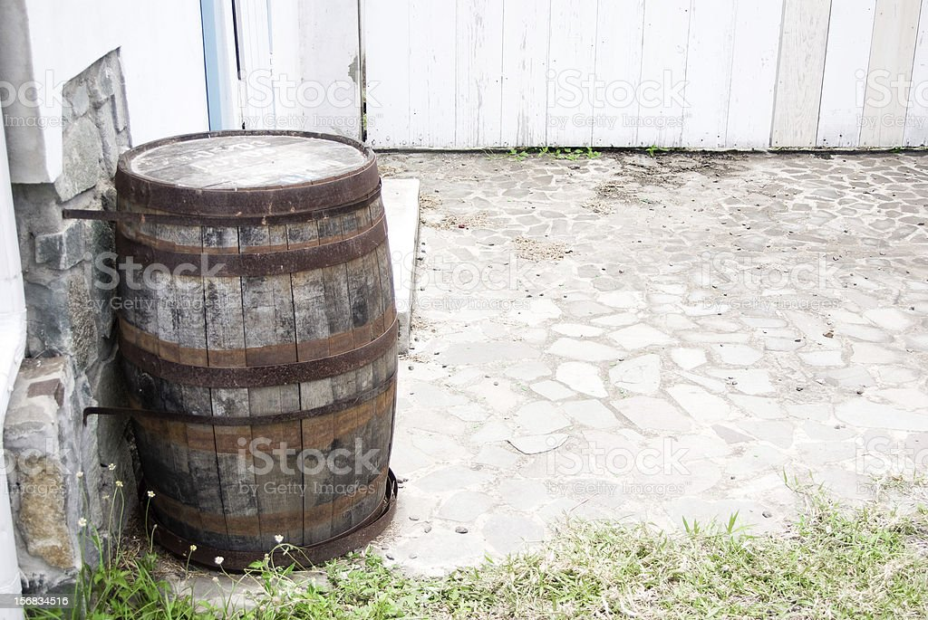 abandoned yard with wooden storage cask royalty-free stock photo