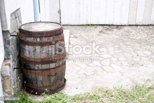 abandoned yard with wooden storage cask