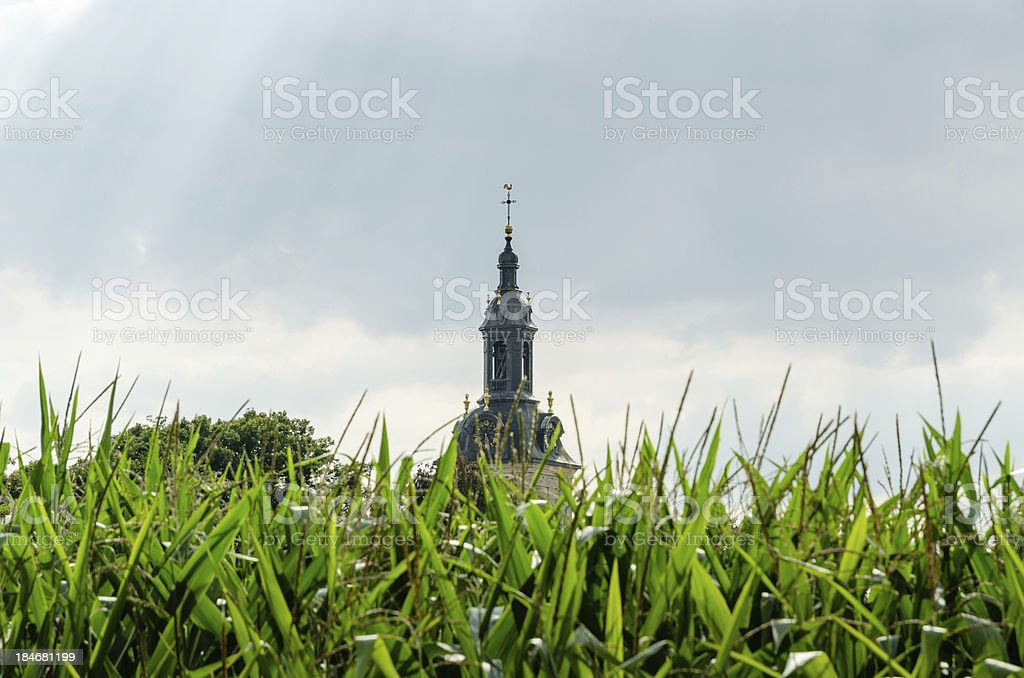 Abbey church in the cornfield royalty-free stock photo