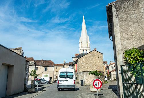 Deux-Sèvres, France. Thursday 23 July 2020. Van on a narrow road leading to Abbatiale Saint-Pierre d'Airvault, France.