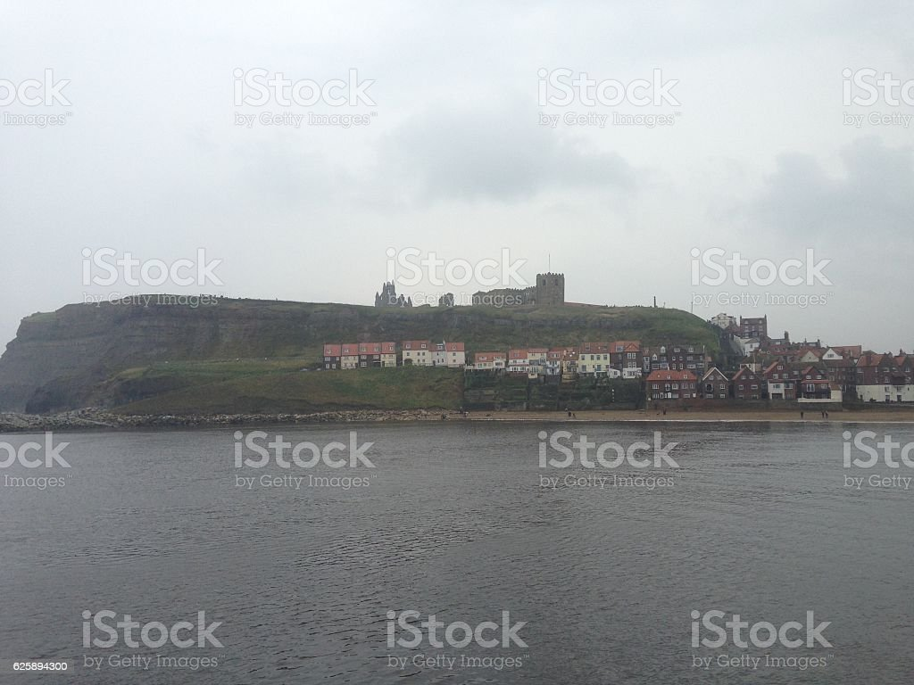 Abbey on the hill with houses in Whitby stock photo