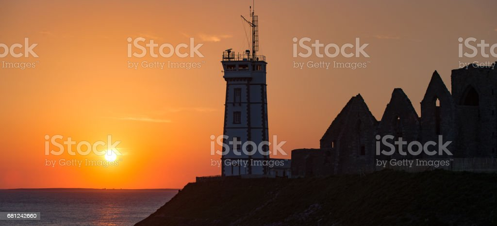 Abbey ruin and lighthouse, Pointe de Saint-Mathieu, Brittany, France royalty-free stock photo