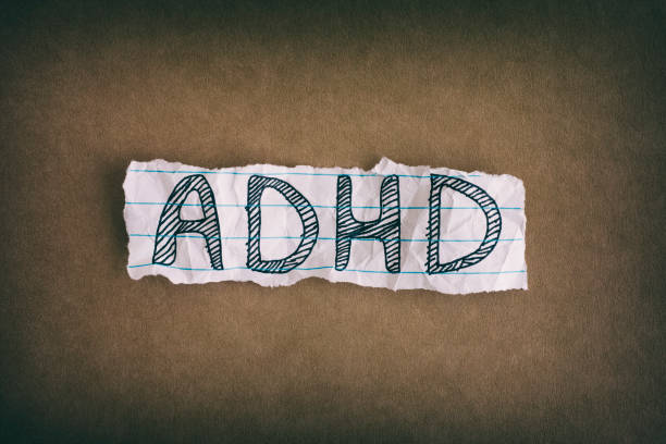 Abbreviation ADHD on brown background stock photo