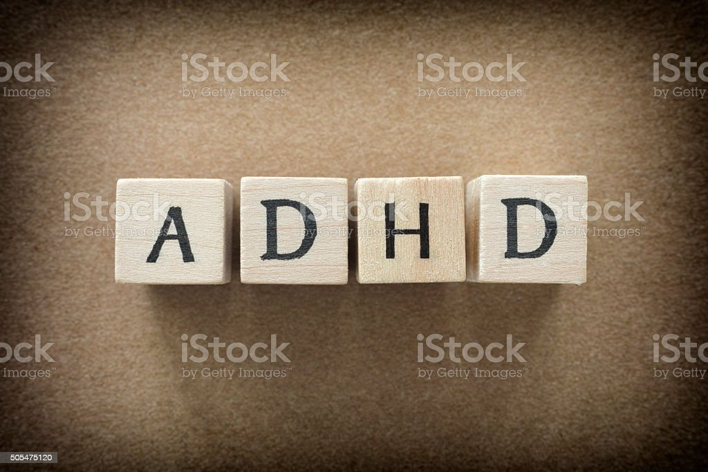 ADHD abbreviation on wooden blocks stock photo