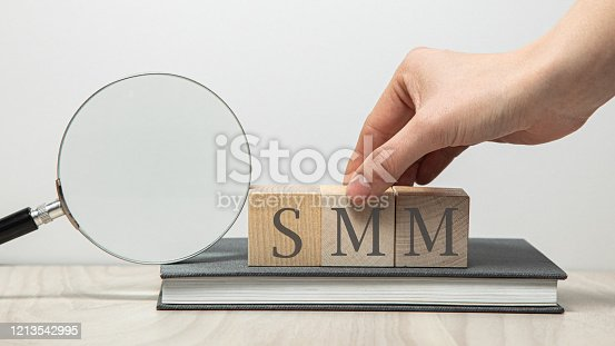istock SMM abbreviation on wooden cubes 1213542995