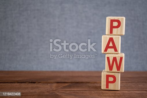istock Abbreviation PAWP (pulmonary artery wedge pressure) text acronym on wooden cubes on dark wooden backround. Medicine concept. 1219422403