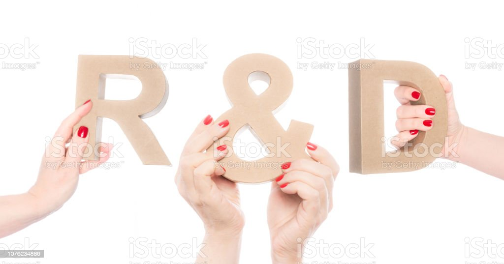 R&D abbreviation, research & development in cardboard letters stock photo