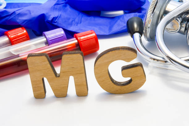 mg abbreviature mean magnesium electrolyte with lab tubes with blood and stethoscope. using acronym mg in laboratory clinical diagnosis, determination of pathologies contacts to deficiency - deficient stock pictures, royalty-free photos & images