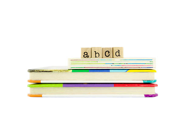 abcd word on wood stamps and children's board books stock photo