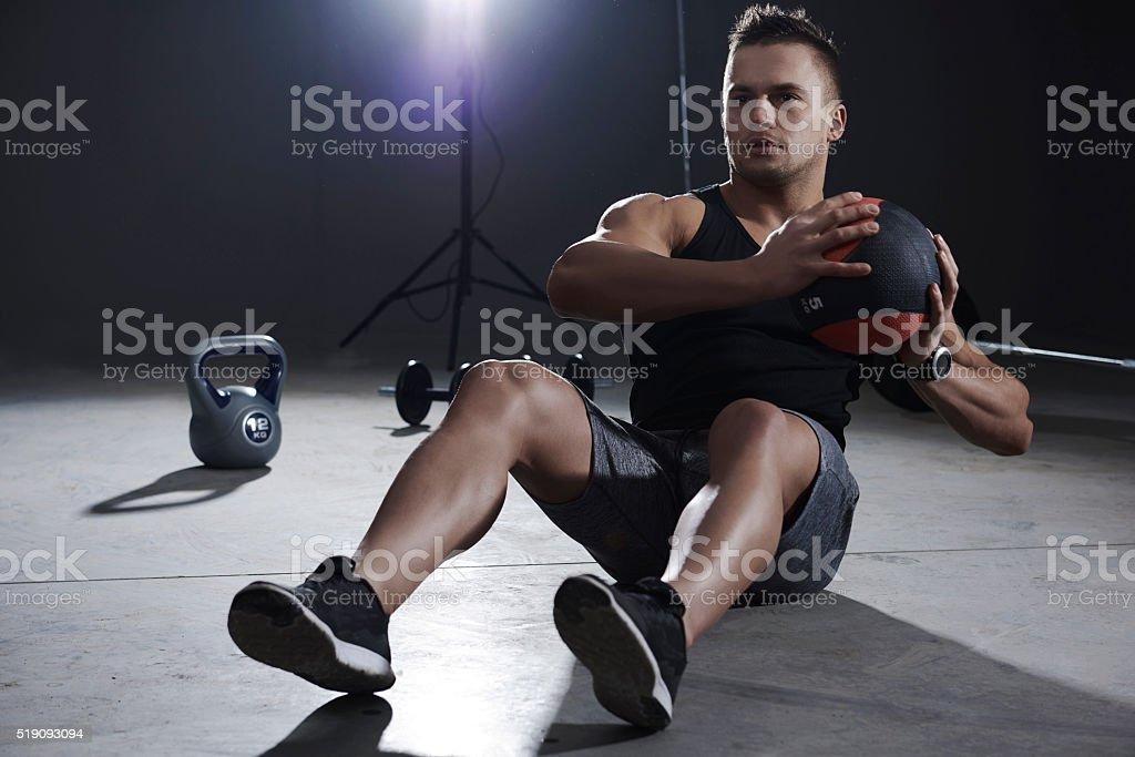 Abdomen exercise with medicine ball stock photo