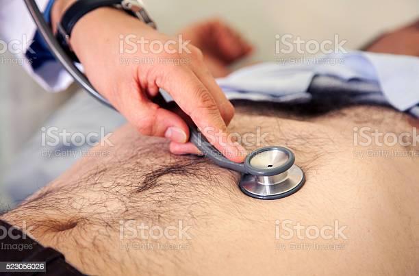 Abdomen Stethoscope Examination Stock Photo - Download Image Now