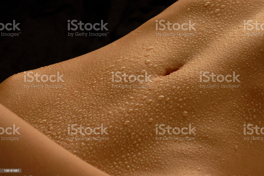 abdomen with waterdrops royalty-free stock photo