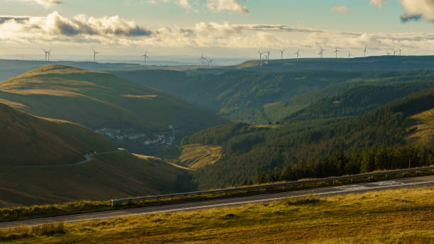 Abergwynfi, Wales, UK Wind turbines on the hills near Abergwynfi in Neath Port Talbot, West Glamorgan, Wales, UK south wales stock pictures, royalty-free photos & images