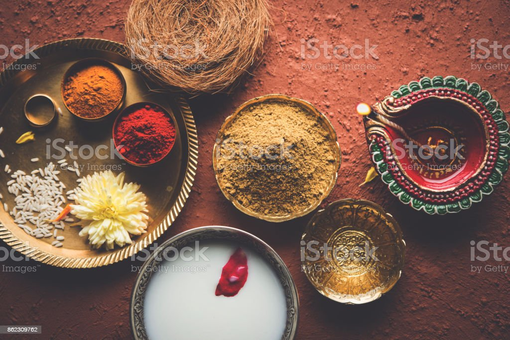 Abhyanga Snan on first day of Diwali - special herbal bath with ubtan or Utne, a mix herbal powder to have bath and scrub on the occasion of Diwali, selective focus stock photo