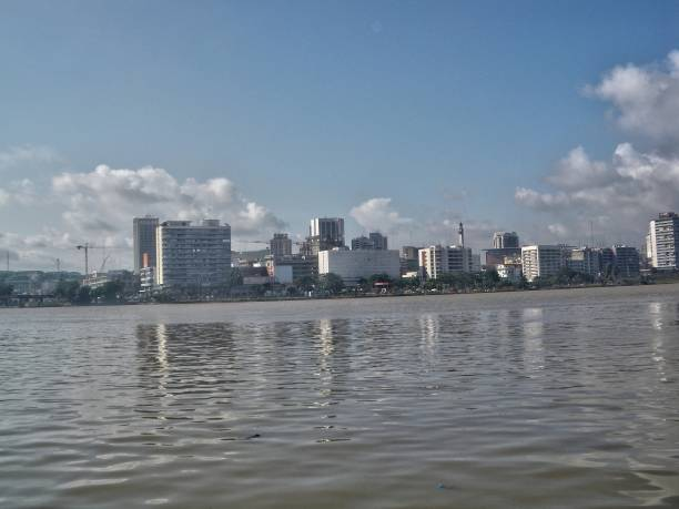 Abidjan downtown buildings Abidjan downtown buildings seen from the lagoon côte d'ivoire stock pictures, royalty-free photos & images