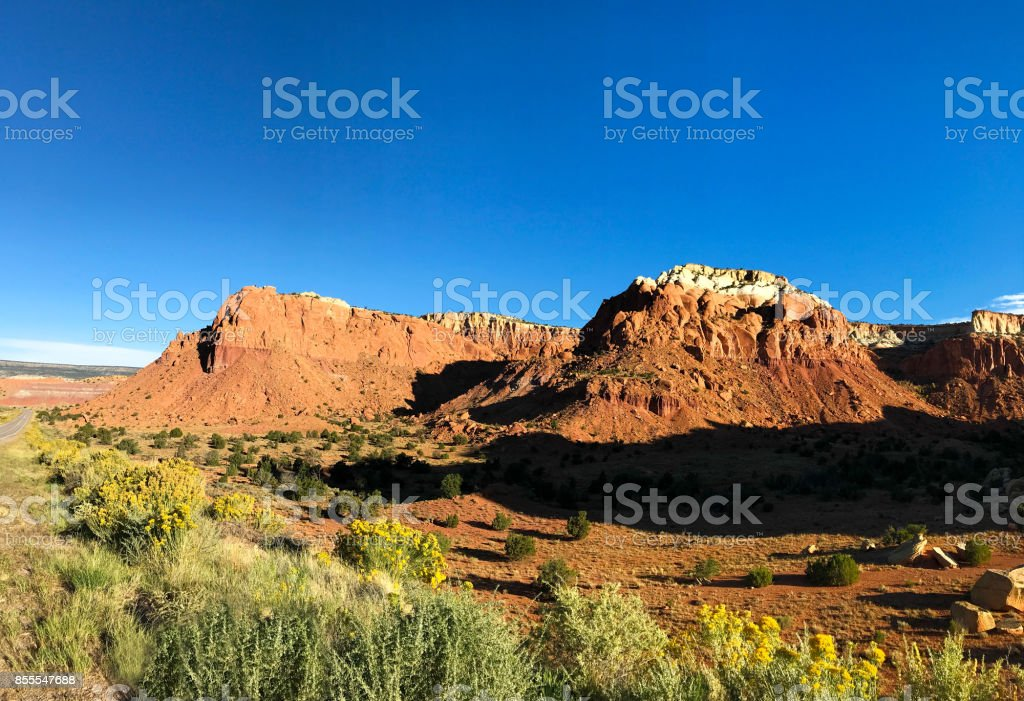Abiquiu, NM: Red Mountain Cliffs and Chamisa/Rabbit Brush stock photo
