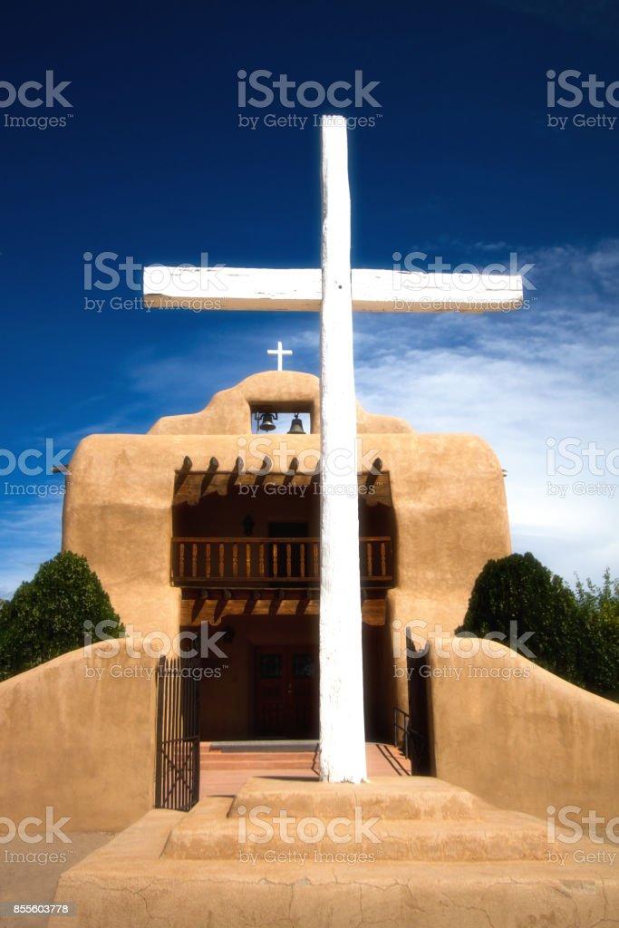 Abiquiu, NM: St Thomas Catholic Church with White Cross stock photo