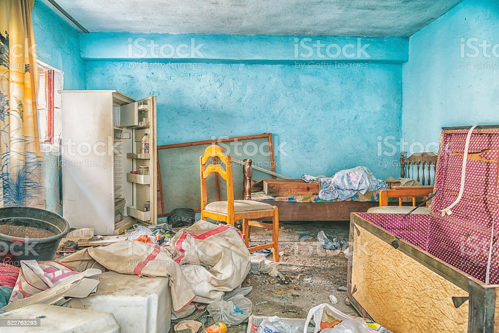 Destroyed old mess interior with old wares