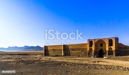 View on abonded caravansarai in the desert by Varzaneh - Iran