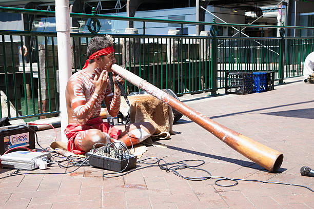 aborigin performed music at harbour in sydney,australia - didgeridoo stock photos and pictures