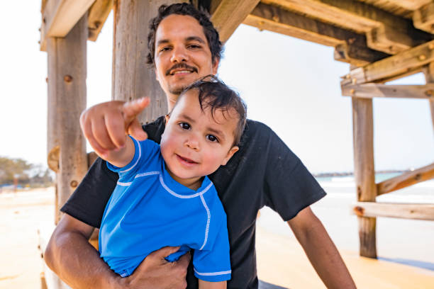 Aboriginal Australian Father and Son at the Beach stock photo