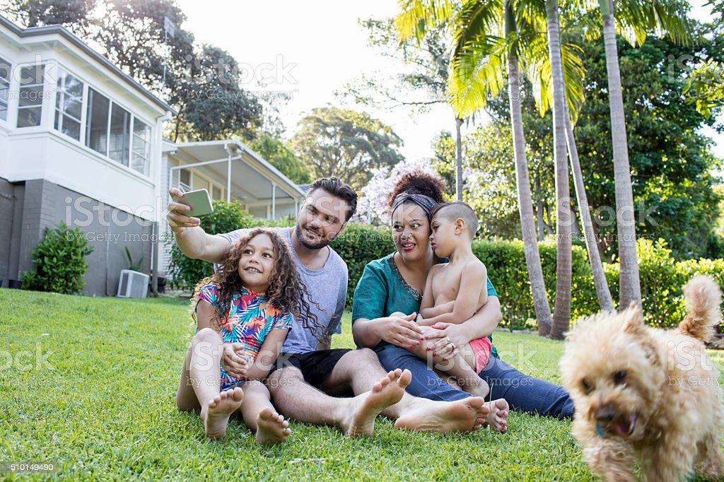 Aboriginal family haing fun in the garden stock photo