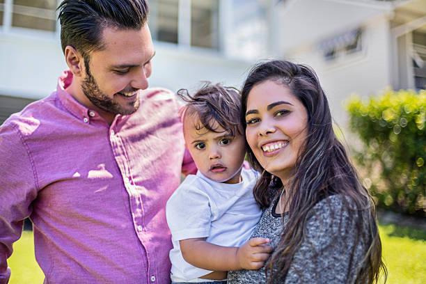 Aboriginal family in the garden stock photo
