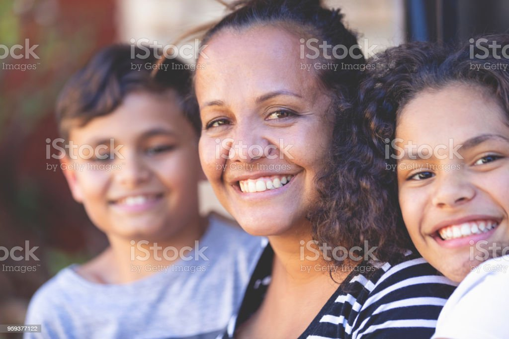 Aboriginal Family portrait with 1 parent and 2 children. stock photo
