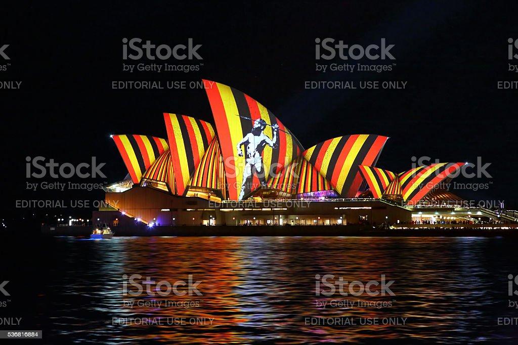 Aboriginal hunter on Sydney Opera House Vivid Sydney stock photo