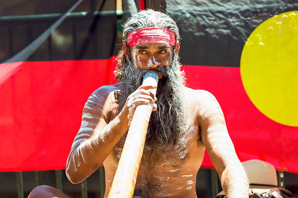aboriginal male playing didgeridoo, street performer, sydney australia - didgeridoo stock photos and pictures