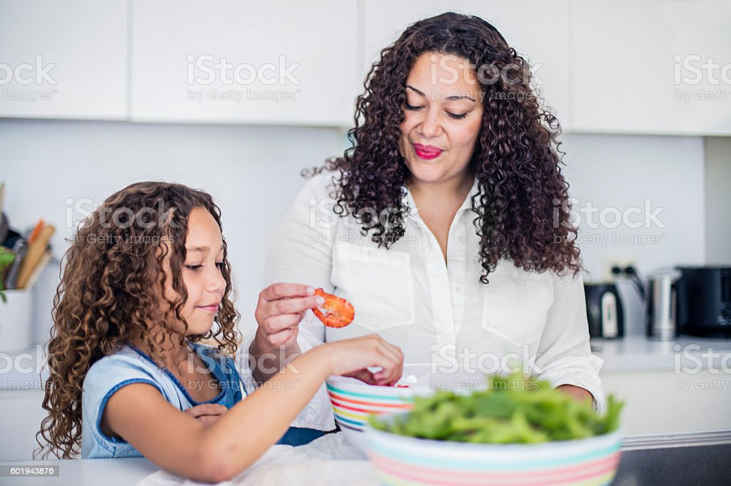 Aboriginal mother and daughter preparing fresh salad stock photo