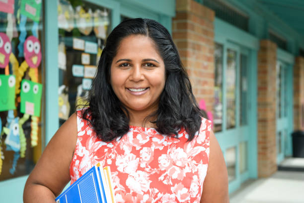 Aboriginal teacher at primary school stock photo