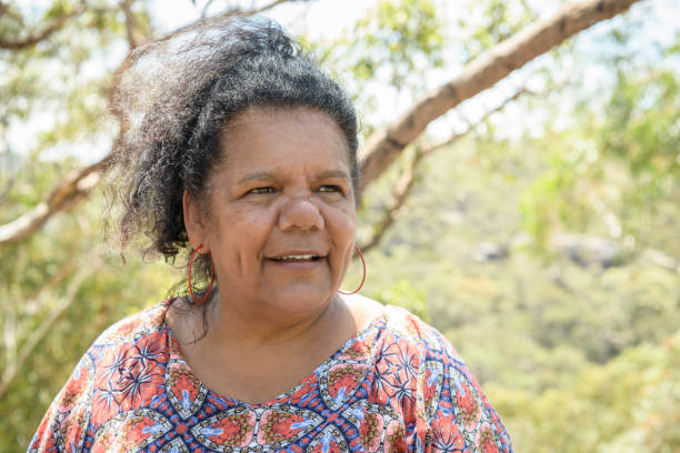 Aboriginal woman smiling and looking away stock photo