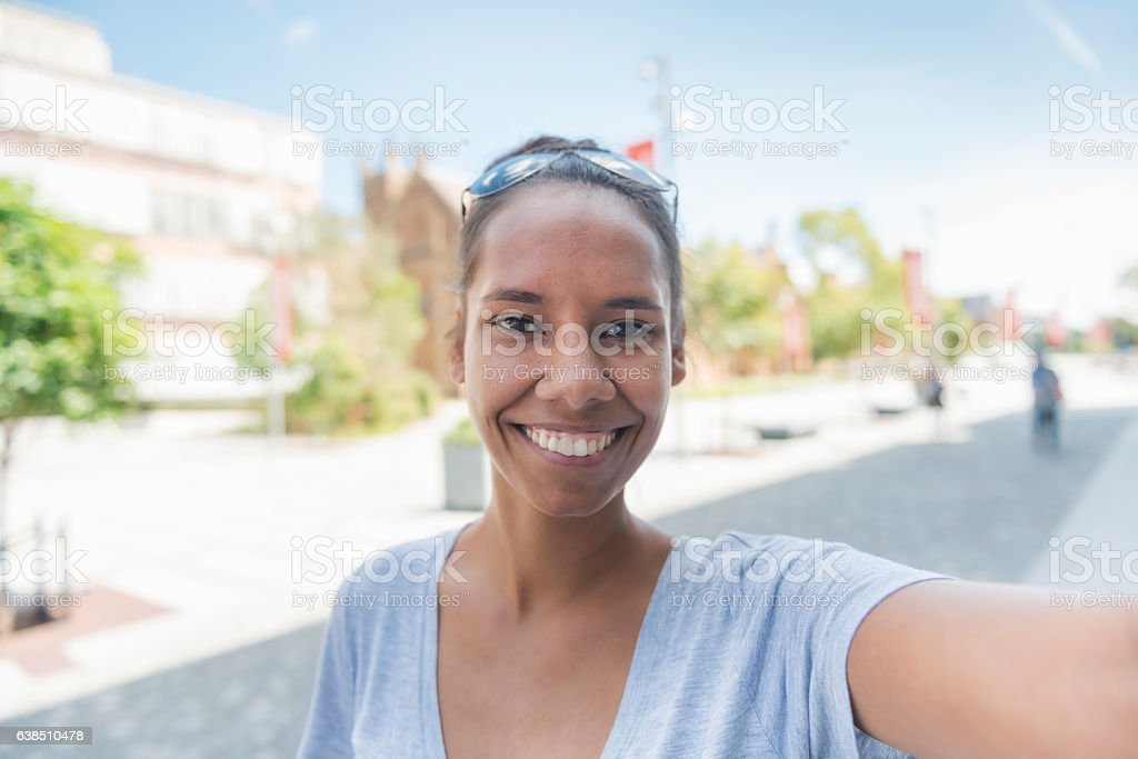 Aboriginal woman taking selfie - POV stock photo