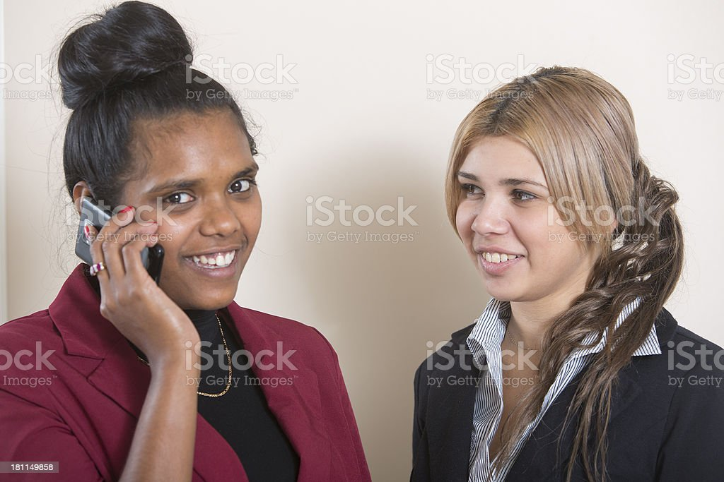 Aboriginal Women Using a Mobile royalty-free stock photo