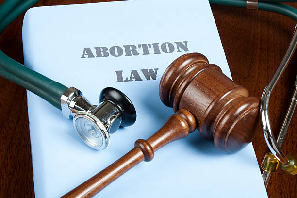 Abortion law and judge's gavel Gavel and stethoscope on Abortion law handbook. abortion stock pictures, royalty-free photos & images