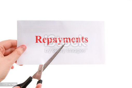 scissors ready to cut repayments in half