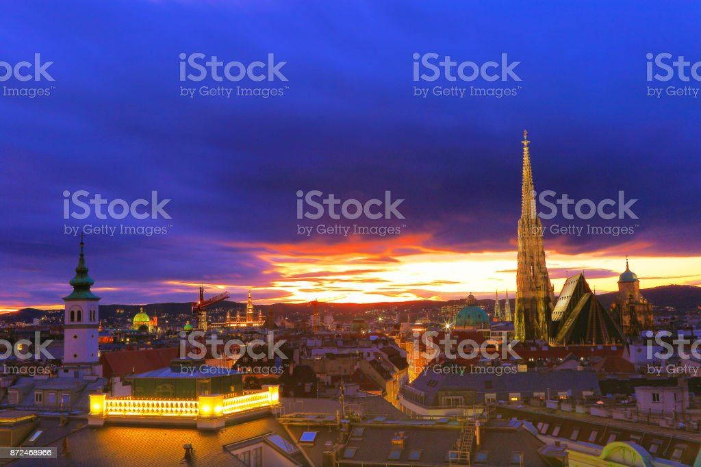 Above Beautiful Vienna Cityscape panorama, with St. Stephen's Cathedral, impressive building architecture and urban skyline at dramatic evening – Vienna , Austria stock photo