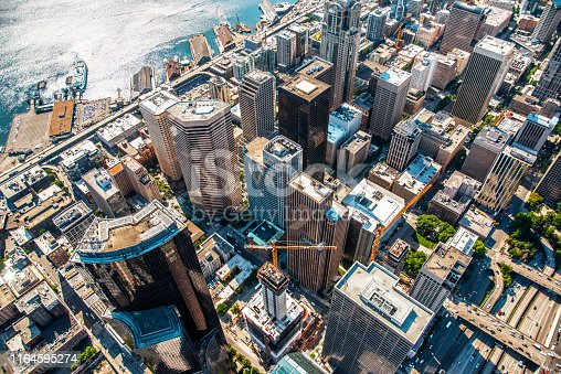 Directly over downtown Seattle at about 1000 feet in altitude highlighting the buildings along the waterfront.