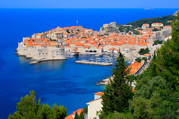 Above Dubrovnik old town with idyllic mediterranean adriatic beach, Croatia stock photo