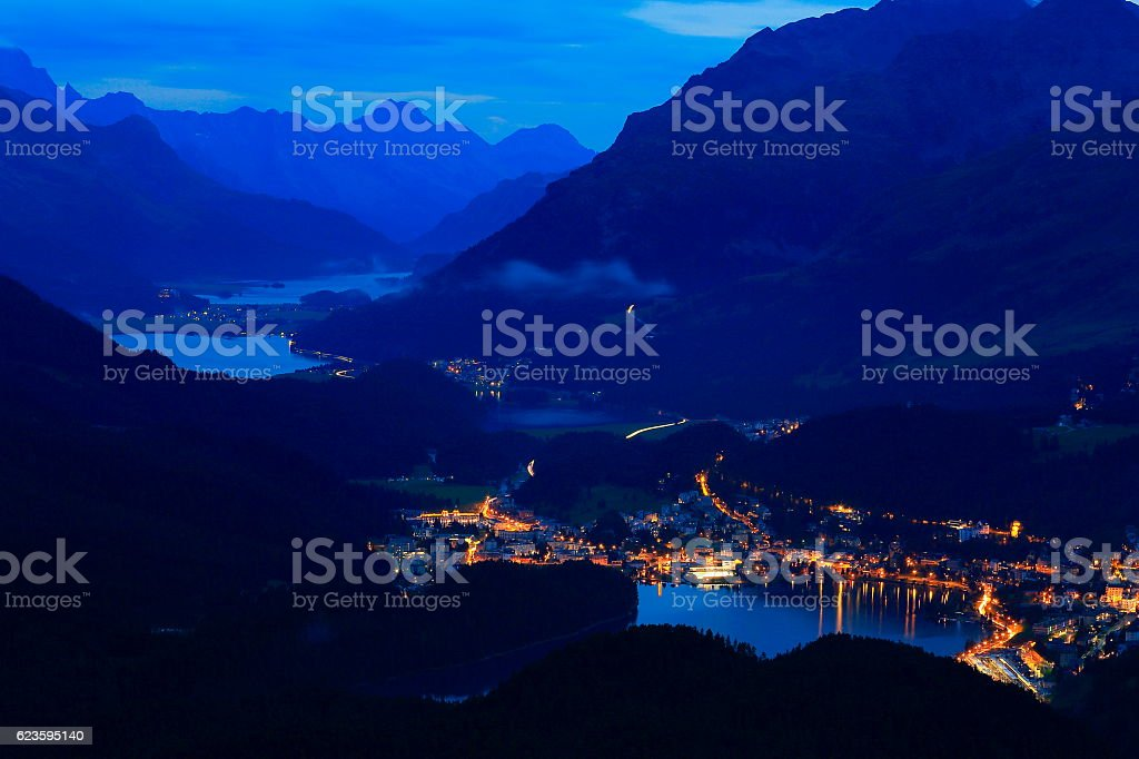 Above Engadine, St Moritz cityscape lights, lakes evening, Swiss Alps stock photo