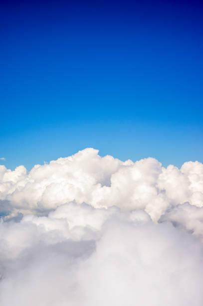 Above fluffy clouds Deep blue sky above fluffy white clouds. altocumulus stock pictures, royalty-free photos & images